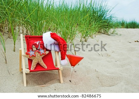 starfish with sunglasses and Santa hat with drink on the beach