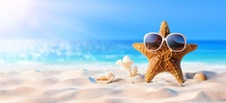Starfish With Sunglasses In The Sunny Beach