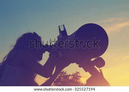 Stargazing through a telescope.