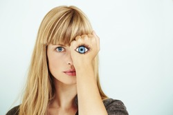 Staring blond woman with painted eye