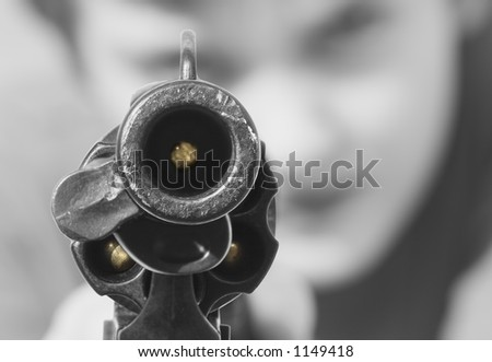 Staring down a loaded gun - stock photo