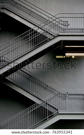 Stark Lines Of A Modern Metal Industrial Staircase On The Exterior Of A  Factory In Singapore
