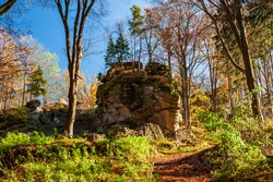 Starkov castle ruin. Evening sunbeams on meadow. Warm sun light in countryside of Bohemian Moravian Highlands, Zdar Hills, Vysocina, Czech Republic.