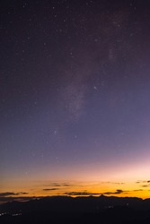 Starry colorful sky with early morning light.