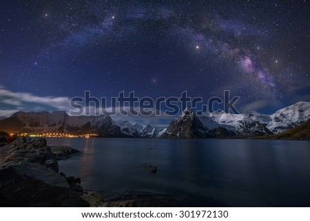 Starry Night.\ Our home galaxy over the the village of Hamnoy in the circle arctic of Norway.
