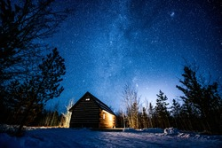 Starry night over a cabin in Whitehorse, Yukon, Canada