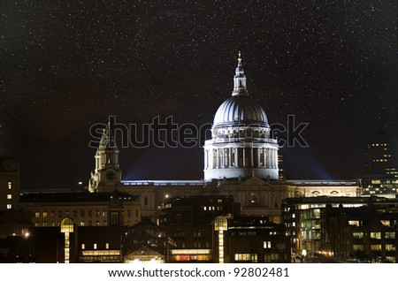 Starry night sky above St. Paul's cathedral, London, UK.