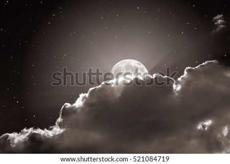 Starry night sky with clouds and full moon