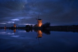 starry night sky with dutch windmills