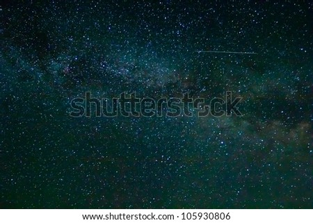 starry night sky with satellite trail