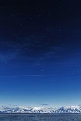 Starry Night Twilight Lake and Mountain Background at Antelope Island at the Great Salt Lake of Utah