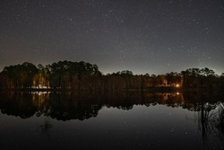Starry reflections over Lake Ratcliff in Davy Crockett National Forest (Texas).