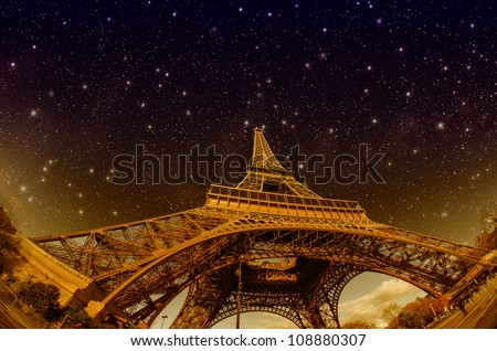 Stars and Night Sky above Eiffel Tower in Paris, France