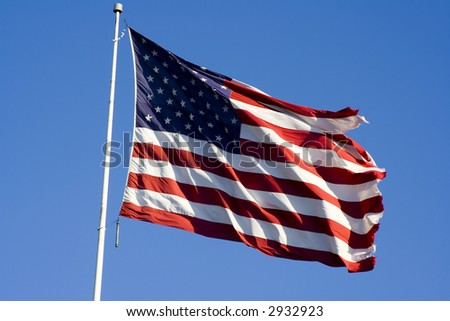 Stars and stripes flying in the wind on deep blue sky nice background for a patriotic display