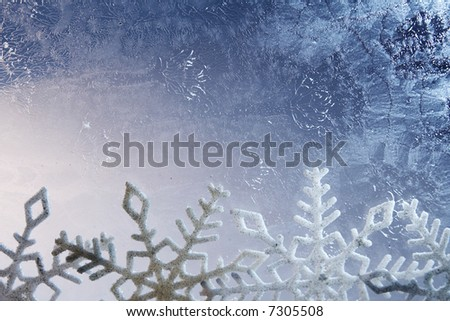Stars chain on a frozen glass background
