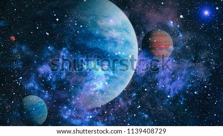 Stars of a planet and galaxy in a free space. Elements of this image furnished by NASA .