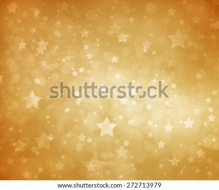 Stars on gold background. Luxury gold star background. Glittering white stars at night. Stars shining in sky. Yellow background. Gold background.