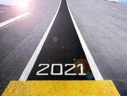 Start and look ahead to the future in new year two thousand twenty one (2021), painted on a runway of an aircraft carrier with lens flair effect