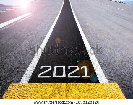 Start and look ahead to the future in new year two thousand twenty one (2021), painted on a runway of an aircraft carrier with lens flair effect Сток-фото ©