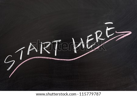 Start here words and arrow  drawn on the chalkboard