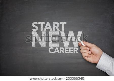 Start new career on black Blackboard with hand holding chalk