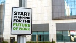 Start Planning for the future of work sign in a downtown city setting