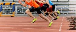 start sprint men runners run 100 meters at stadium
