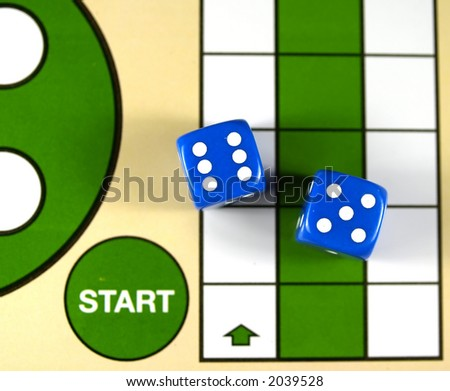 start square on table game and two dice - stock photo