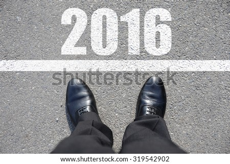 Start to new year 2016 - top view of business man walking on the road #319542902