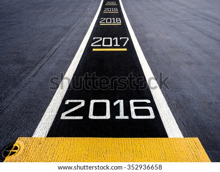 Start to new year two thousand sixteen (2016) and head to 2010, painted on a runway of an aircraft carrier