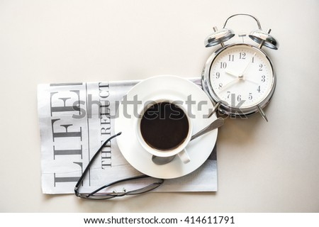 Start up concept.Coffe cup,alarm clock,newspaper,books,glasses.morning coffee day start.Education business place, vintage tone