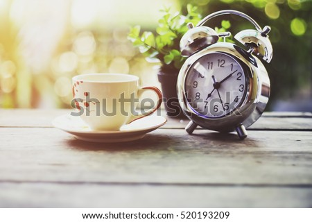 Start up concept.Coffe cup,alarm clock,notebook.morning coffee day start.vintage tone