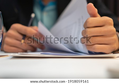 Start up learning for Document report business note in meeting room concept: Businessman manager hands writing for reading, signing in paperwork or documentation files at corporate on office desk