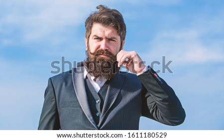 Start with grooming routine and ultimately lead better world. Man bearded hipster wear formal suit blue sky background. Vintage style beard. Facial hair beard and mustache care. Beard fashion trend.