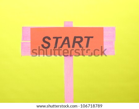 Start wooden board on green background