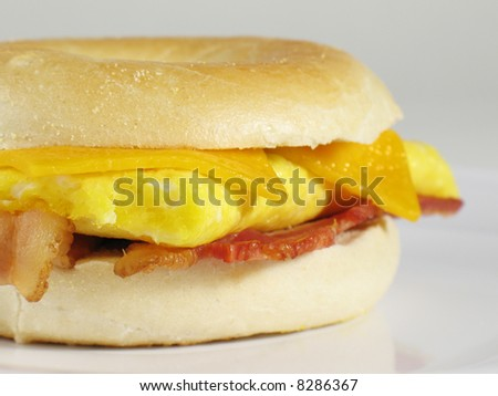 Start your morning right with this delicious breakfast sandwich… a sliced bagel filled with bacon, eggs, and cheese!