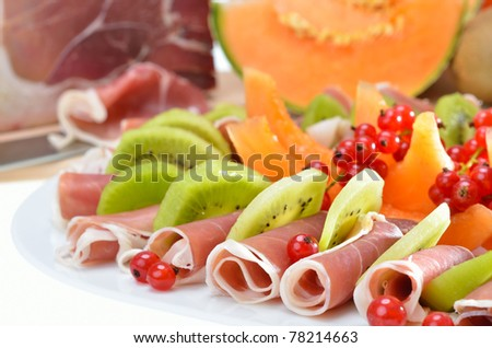 Starters plate with Italian ham and ripe fruits