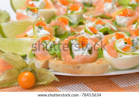 Starters with salmon, cheese and caviar