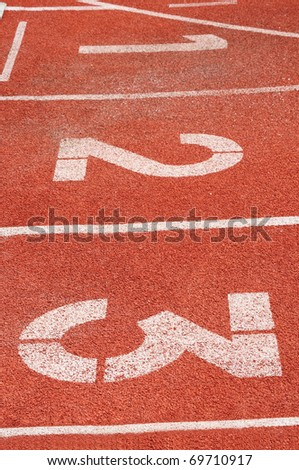 Starting blocks of red running track, one two three