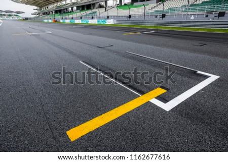 Starting grid asphalt, race track detail. Motorsports racing circuit close up. #1162677616