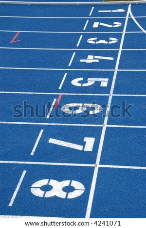 Starting line of blue running track - stock photo