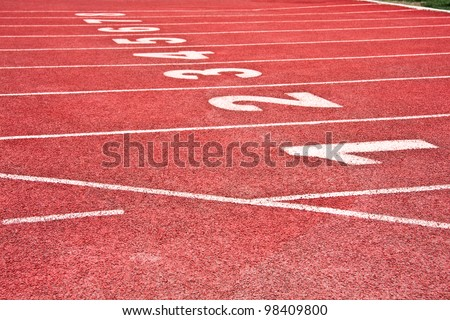 starting line on a red running track