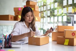 Starting small businesses SME owners female entrepreneurs Write the address on receipt box and check online orders to prepare to pack the boxes, sell to customers, sme business ideas online.
