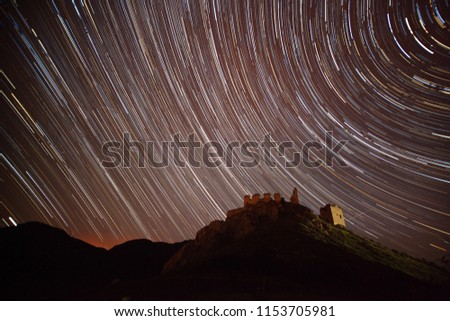 startrails over abandonded castle - starry night in August