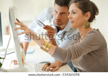 Startup business partners working together in desktop #534365098