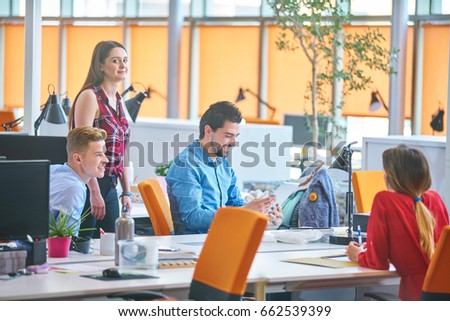Startup business people group working everyday job at modern coworking  office space #662539399