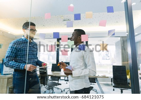 Startup business people group working everyday job at modern office. Tech office, tech company, tech startup, tech team. #684121075