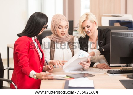 Startup Business Team on Meeting in Modern Bright Office Interior Brainstorming - Shutterstock ID 756021604