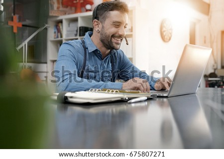 Startup entrepreneur making video conference call
