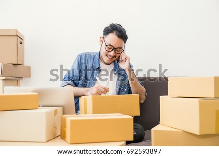 startup small business entrepreneur SME freelance man working with box, Young Asian small business owner office, online marketing packing box delivery, SME delivery e-commerce telemarketing concept